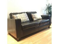 Black leather two seater lounge