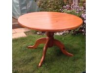 3ft 6ins round pine table with 4 chairs. In Antique pine.