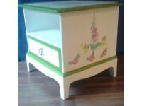 Bedside cabinet, decorated with Harts tongue fern on top and foxgloves and primroses on the side