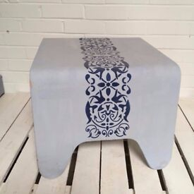 Curved coffee table with stencil design