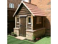 Garden shed with brick plinth and tiled roof