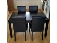 IKEA BJURSTA Extendable table (140/180/220x84cm) - Brown-Black and 4 HENRIKSDAL Black Leather Chairs