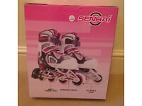 senhai childs roller blades mint condition 33 36 size hardly worn at all clean white and red thanks