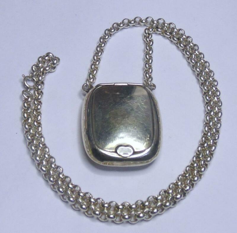 ANTIQUE SILVER LOCKET AND CHAIN