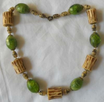 1930s Art Deco Style Jewelry VINTAGE 1930S EARLY PLASTIC CORK EFFECT BEADS & SWIRLY GREEN BEADS NECKLACE $34.81 AT vintagedancer.com