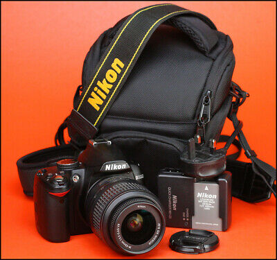 Nikon D3000 DSLR Camera Body + Nikon 18-55mm VR Zoom Lens Kit + 2007 Shots