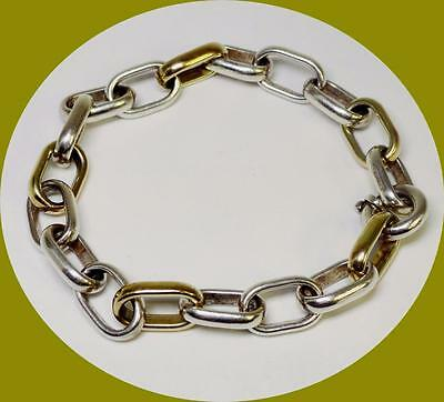 UNISEX STERLING SILVER AND 14K YELLOW GOLD LINK BRACELET BY OTC INTERNATIONAL