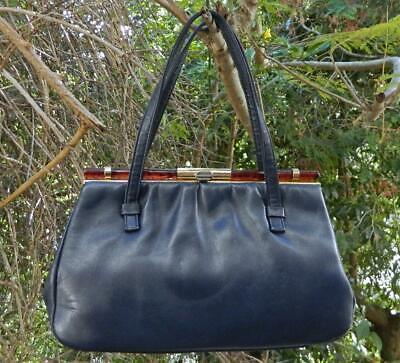 1950s Handbags, Purses, and Evening Bag Styles VINTAGE Faigen 1950s Original Rockabilly Leather Tortoiseshell Retro Handbag $63.66 AT vintagedancer.com