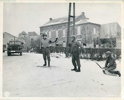 WWII U.S. MP Halts Sledding 1st Army Soldiers for Traffic in Belgium Press Photo