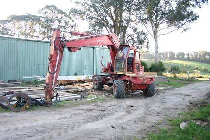 Wheeled excavator with rotating log grab and buckets. Kinglake Central Murrindindi Area Preview
