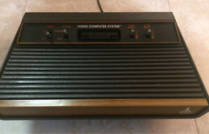 Atari 2600 full system + 15 games + 2 paddles