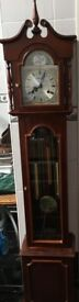 GRANDMOTHER CLOCK MECHANICAL KEY WIND. APPROX 5foot 6inch HIGH. MAHOGANY A VERY PETITE SIZE