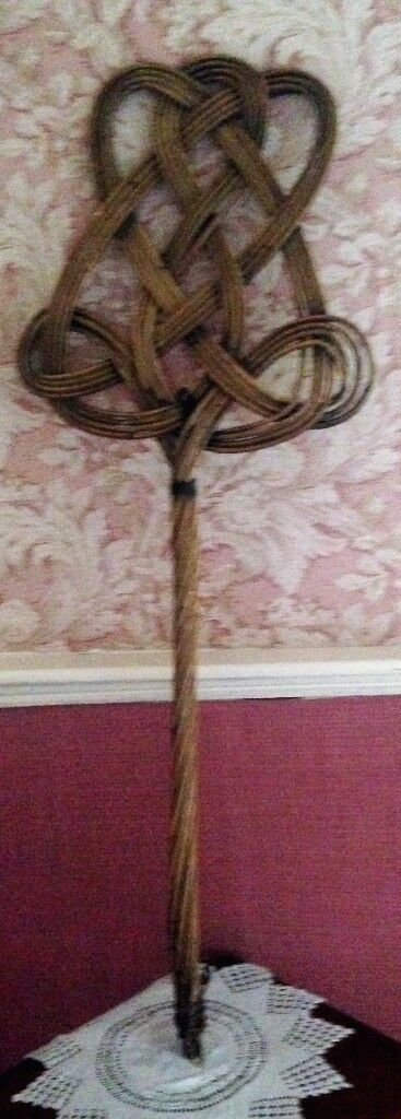 Genuine antique wicker carpet beater. Would be in place in a Victorian period drama.