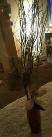 Vase with flower/twig arrangement
