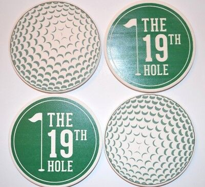 - The 19th Hole Golf set of 4 Coasters Cork Base Golf Ball Image Ceramic Coasters