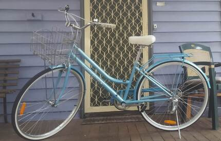 Blue vintage style bicycle for women with helmet, lock and pump
