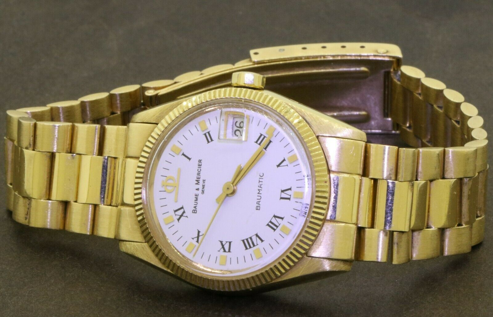 Baume & Mercier Baumatic heavy 18k yellow gold 30mm automatic watch with date - watch picture 1
