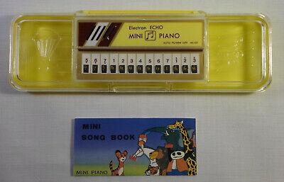 ELECTRON ECHO VTG 80's MINI PIANO + SONG BOOK IN CLEAR YELLO