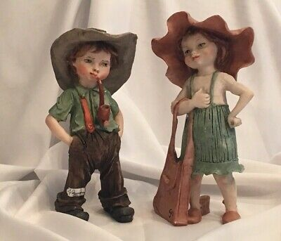 Giuseppe Armani  Gullivers World. Girl and Boy playing dress-up. (Boy And Girl Dress Up)