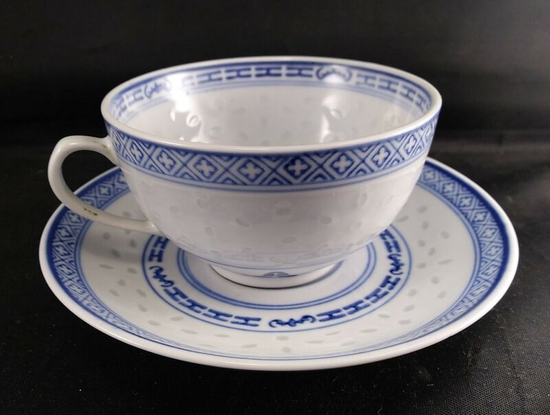 Chinese Rice Grain Rice Eyes Tea Cup and Saucer Made in China Lotus flower
