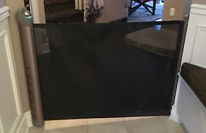 Retractable baby gate / pet barrier ($60)