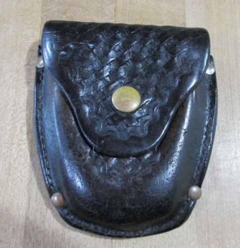 Jay Pee Black Leather Handcuff Holster basket weave.  (sp)