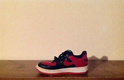 Nike Air Force 1 shoes for boys, size 1y, right shoe only, car mirror display.