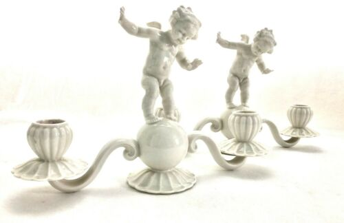 A Vintage Pair of German Hutschenreuther Porcelain Balancing Putti Candelabras