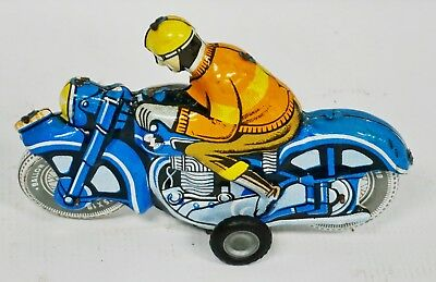 VINTAGE HUNGARIAN TIN FRICTION MOTORCYCLE RIDER TOY HUNGARY