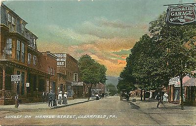 C1910 Postcard Sunset On Market St  Clearfield Pa Business District Signs Posted