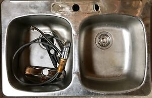Double sink and moen single pull tap