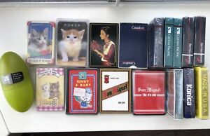 Assorted playing cards cats, umbra, airlines, beer