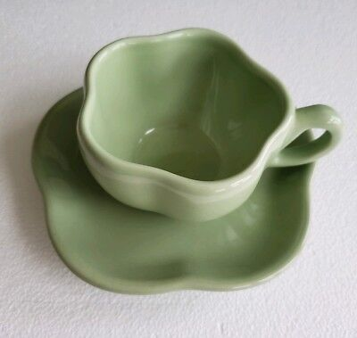 HENN POTTERY WORKSHOPS OF GERALD HENN PASTEL GREEN CUP AND SAUCER