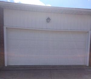 Garage door includes opener