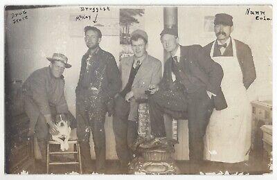 1910 Nunn, Colorado - Interior of Drug Store & Dog - REAL PHOTO Vintage -