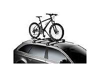 2 Thule Bike Racks and Roof Rack and Rail Bars for a Kia Sportage