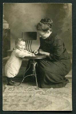 RPPC SMILING BABY & MOTHER by METAL CHAIR ANTIQUE REAL PHOTO POSTCARD c 1910