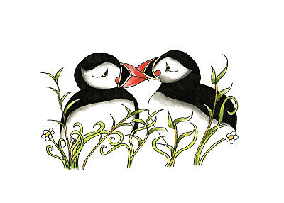 TWO PUFFINS IN THE GRASS