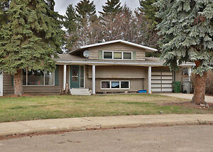 Alberta Side Four Level Split with Huge Yard! - Available Today!