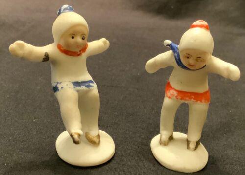 VINTAGE GERMAN BISQUE SNOWBABY - BOY & GIRL SKATERS