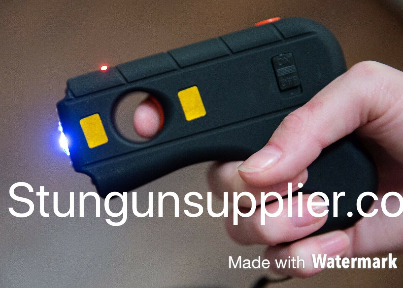 Defender Stun Gun Tactical High Powered LED Light W/ Safety Switch and Case Blac