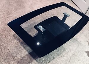 Modern black glass coffee table in excellent condition