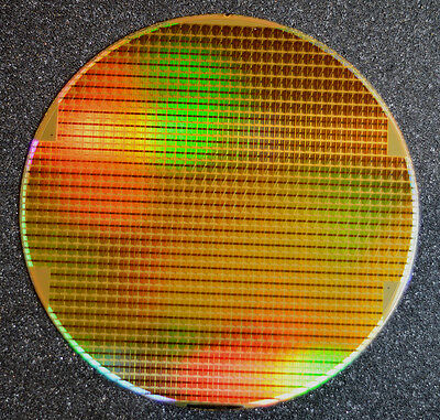 Silicon Wafer 8 inch, Dynamic RAM  that is Iridescent gold and copper in color