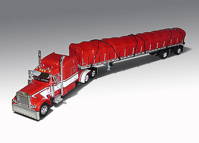 Dcp 379 Peterbilt Mid Roof Sleeper  Dan Ribble  With Covered Wagon Trailer1 64