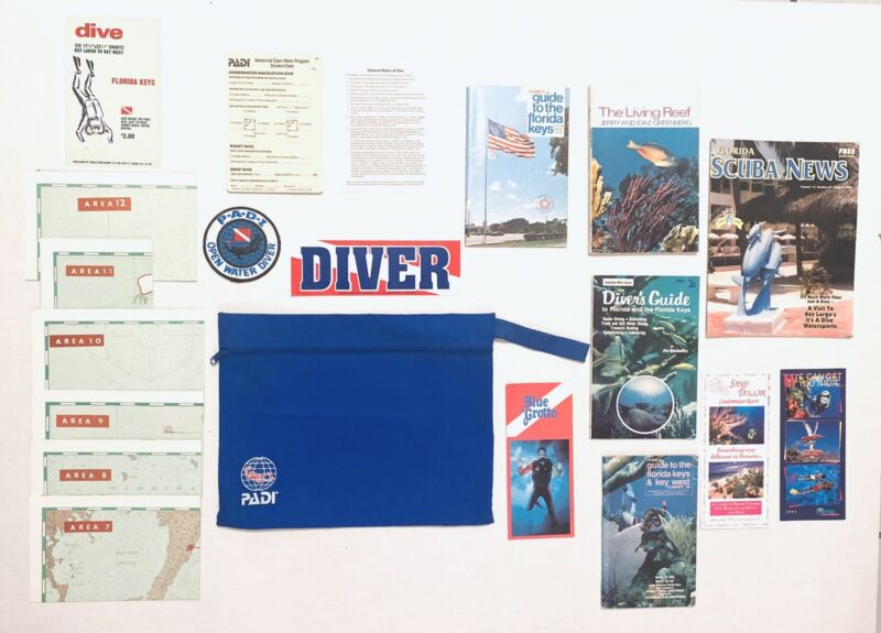 Vintage Assorted Dive Books and Brochures with Lot of 1990's PADI Accessories