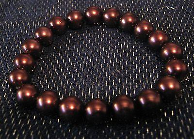 Bracelet Elasticated warm metallic brown tone heavy beads very chic!