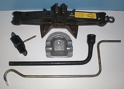 97 Chevy Geo Metro Scissor Jack Lug Wrench Hub Cap Tool Spare Tire Hold Down Set