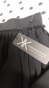 Kardashian Kollection NEW  black lace skirt size S Essendon Moonee Valley Preview