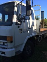 Isuzu 500 tray truck with ramps Nerang Gold Coast West Preview