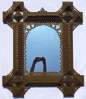 An extremely well made, large, unusual tramp art frame. GREAT PIECE!